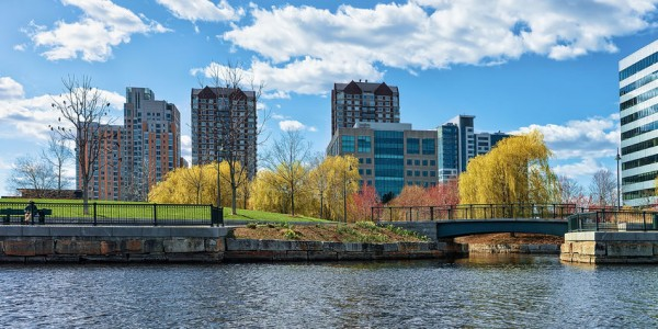 83182946 - modern buildings at north point park and charles river in cambridge, massachusetts, america.