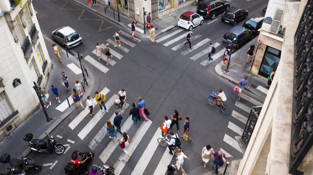 This is a view from a Paris apartment 3rd floor window in arrondissement 7 of the street intersection below.